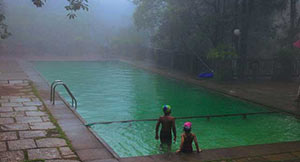 swimming pool at vythiri Resort